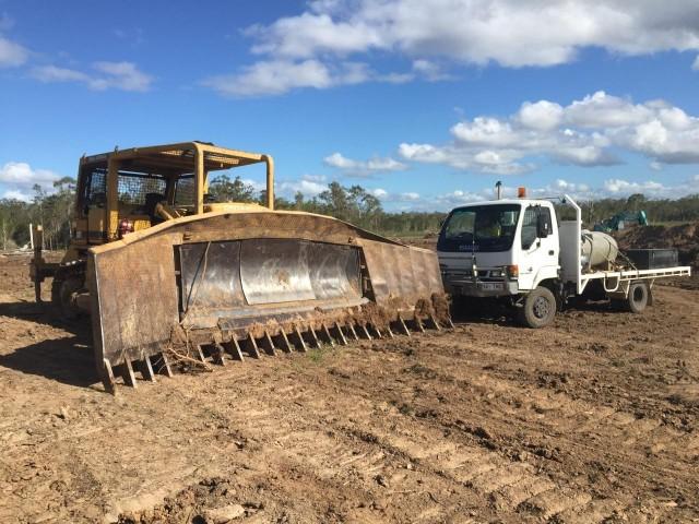 Caterpillar D7G Dozer w/stickrake for hire in Kilcoy, QLD 4515