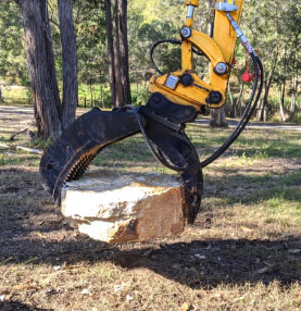 Medium sized excavator on dirt