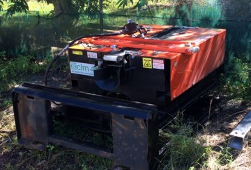 Wombat Cable Pusher set up on a Skid Steer 4 in 1 frame