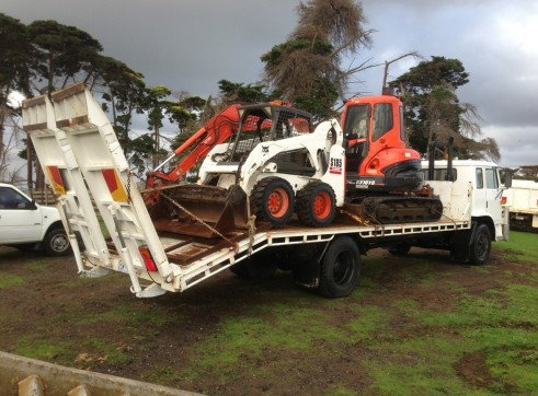 6 tonne excavator & bobcat combo on flatbed 1