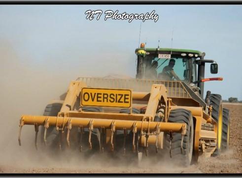 John Deere 8360R Tractor w/ laser bucket 1
