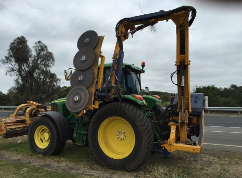 John Deere with reach with saw blades and mulcher 1